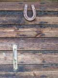 Lucky horseshoe on barn door. Lucky horseshoe nailed to barn door at farm Royalty Free Stock Images