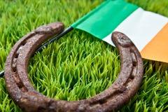 Lucky Horseshoe and Irish Flag Stock Image