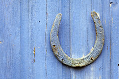 Lucky Horseshoe nailed to door Royalty Free Stock Photos