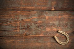 Lucky horseshoe. On old wooden background Royalty Free Stock Photography