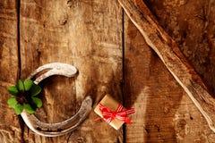 Lucky horseshoe, shamrock and gift Royalty Free Stock Photos