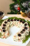 Lucky horseshoe-shaped russian salad for New Year Royalty Free Stock Images