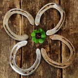 Lucky horseshoes arranged as a shamrock Stock Photography