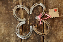 Lucky horseshoes with blank gift tag Royalty Free Stock Images