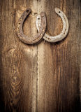 Lucky Horseshoes On Old Wall Fotografia Stock Libera da Diritti