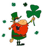 Lucky Leprechaun Holding Up A Shamrock Stock Photos