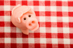 Lucky marzipan pig on tablecloth Stock Photos
