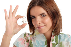 Lucky number. Pretty young woman holding dices royalty free stock images