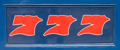 Lucky number 777. Blue and red lucky number 777 sign royalty free stock image