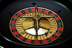 Lucky number seven. Roulette wheel closeup with the ball on number seven stock image