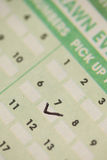 Lucky number seven. Ticked lucky number 7 on the lottery slip stock image