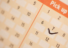 Lucky number seven. Ticked lucky number 7 on the lottery slip royalty free stock photography