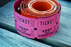 pink raffle tickets on wood Royalty Free Stock Photo