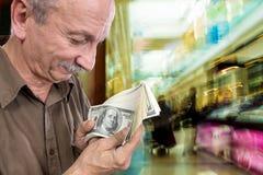 Lucky old man with dollar bills Stock Photos