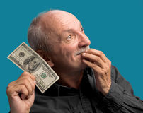 Lucky old man holding dollar bil Stock Photo