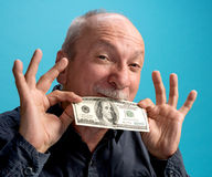 Lucky old man holding dollar bil Royalty Free Stock Photography