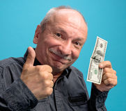 Lucky old man holding dollar bills Royalty Free Stock Image