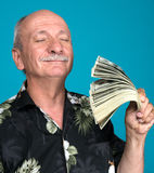 Lucky old man holding dollar bills Royalty Free Stock Photography