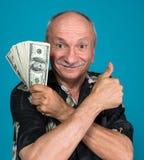 Lucky old man holding dollar bills Stock Photo
