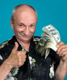 Lucky old man holding dollar bills Stock Images