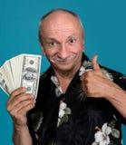 Lucky old man holding dollar bills Stock Image