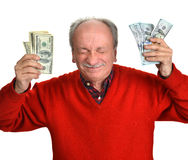 Lucky old man holding dollar bills. On a white background Royalty Free Stock Photo