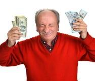 Lucky old man holding dollar bills Royalty Free Stock Photo