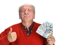 Lucky old man holding dollar bills Royalty Free Stock Photo