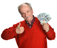 Lucky old man holding dollar bills. On a white background Stock Image