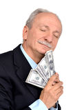 Lucky old man holding dollar bills. On a white background Stock Photo