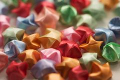 Lucky origami stars. Origami stars made from ribbon Royalty Free Stock Photo