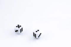 Lucky 7. A pair of dice, on a white surface, showing the lucky roll of 7 stock photos
