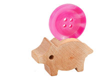 Lucky pig with button Royalty Free Stock Photos