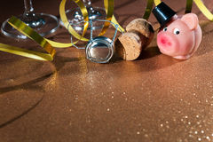 Lucky pig and cork from champagne bottle stock photos