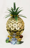Lucky pineapple. Precious metal and jewel bearing pineapple royalty free stock photography