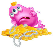 A lucky pink monster lying with the treasures Stock Images