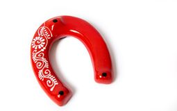 Lucky red horseshoe Stock Image