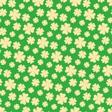 Seamless yellow clover vector pattern over green background stock illustration
