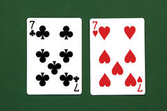 Lucky Seven. Club Seven, Heart Seven on Green Background stock photo