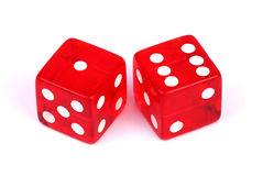 A lucky seven!. Closeup of a pair of red dices that roll a lucky seven over white background royalty free stock photo