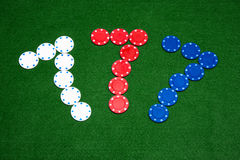 Lucky Seven. 777 Poker Chips Sign on Green Felt stock photo