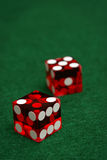 Lucky Seven. A pair of casino quality red dice lie on a green felt table with the number seven rolled Stock Photos