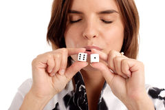 Lucky seven. My lucky number. Portrait of a young woman kissing the dices royalty free stock photography
