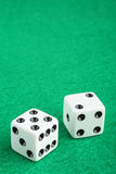 Lucky seven dice on gambling table. Gambling casino concept featuring a lucky seven dice macro closeup on a gambling table with copy space stock photography