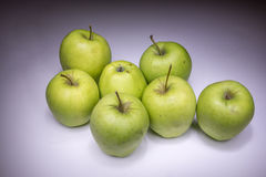 Lucky seven green apples. Painted with light royalty free stock photos