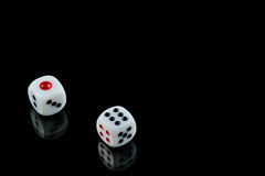 Lucky Seven. A pair of dice, on black, having rolled a lucky seven royalty free stock photography