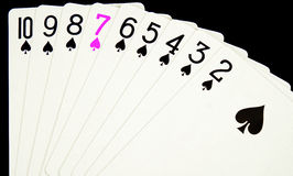 Lucky Seven in Pink. A hand of cards with seven in pink stock photo
