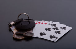 Lucky Sevens. A card hand complete with money and vehicle keys Stock Photo