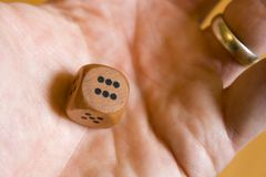 Lucky six on dice. Rolling a six in palm of mans hand Stock Photo