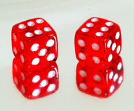 Lucky sixes. A view of two dice on a reflective surface with sixes up Stock Photo